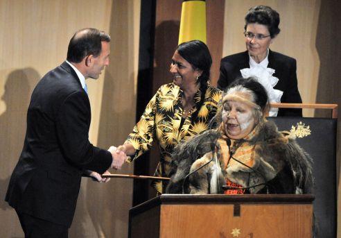 Nova Peris shakes hands with Tony Abbott