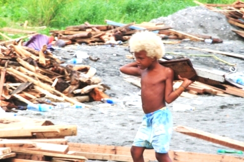 Solomon Islands boy in flood waters