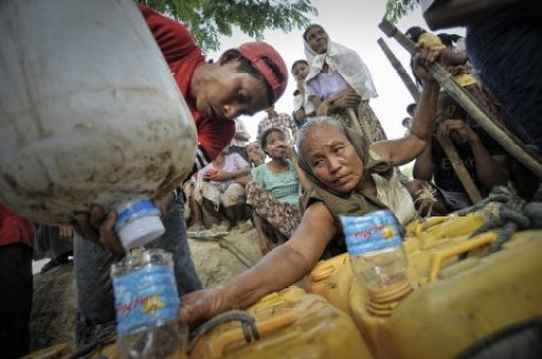 Village woman Myanmar in water rations line