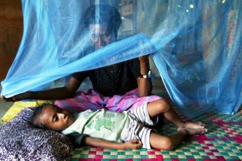 Papua New Guinea child under mosquito net