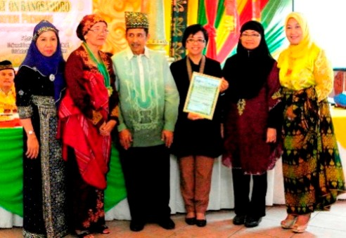 Professor Miriam Coronel-Ferrer with peace partners at the Framework Agreement on the Bangsamoro in the Philippines