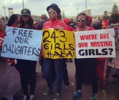 Young women who are not too much older than the girl students who were abducted protest on the streets of Lagos, Nigeria.