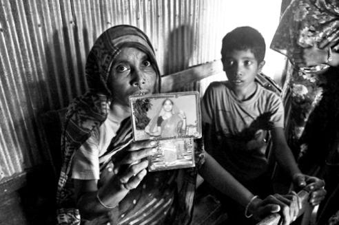 Bibi Zohora's mother with a picture of Bibi