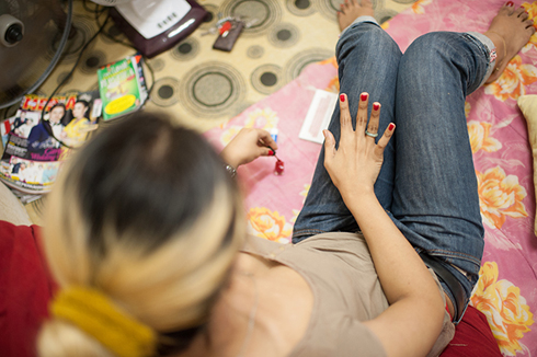 Transgender women in Malaysia paints her nails red.