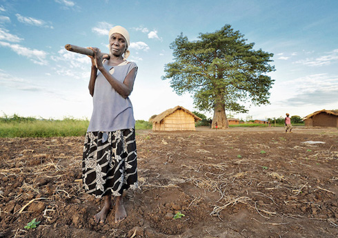 Lucia Makawa standing on her land
