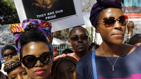 Nigerian women lead rally.