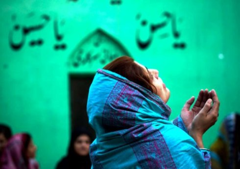Pakistani woman praying