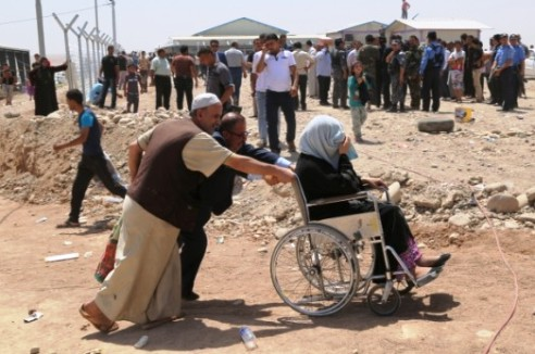Family with wheelchair escape Mosul