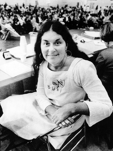 Karen DeCrow in 1977 sitting at the conference table