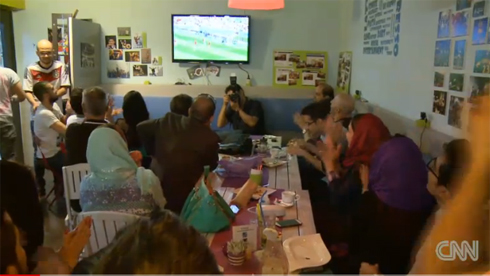 Diners watch World Cup on TV.