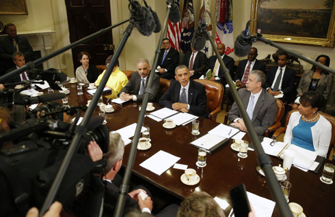 President Obama talks in the Roosevelt Room at the White House