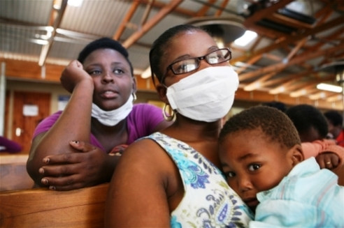 Mother wears TB facemask