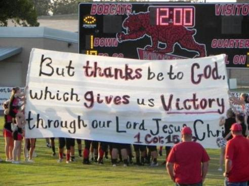 Texas cheerleaders hold up religious banner