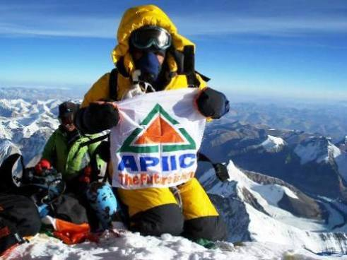13-year-old Purna Malakath sits at the top of Mount Everest