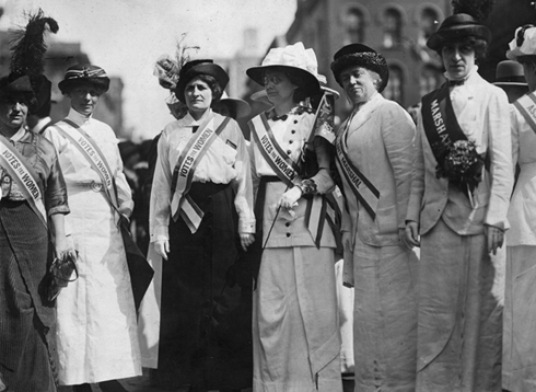 circa 1913:  From left to right, Inez Haynes Gillmore, Hildegarde Hawthorne, Edith Ellis Furness, Rose Young, Katherine Licily and Sally Splint represent female authors, dramatists and editors on a New York Women's Suffrage Parade.  Image: Paul Thompson/Topical Press Agency/Getty Images
