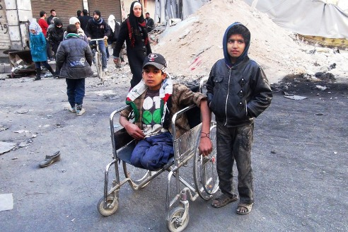 Palestinian boy in wheelchair