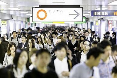 Passengers hurry at Ikebukuro station in Tokyo, Japan