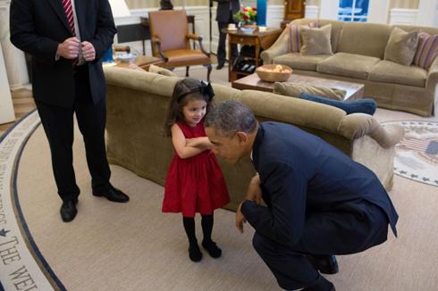 President Obama listens to a little girl