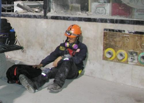 Matt Claussen rests with dog Merlyn at Ground Zero