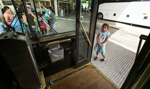 Migrant girl child at U.S. bus station