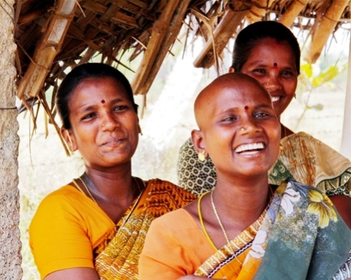 Women in Tamil Nadu (southern India) attend an empowerment seminar.