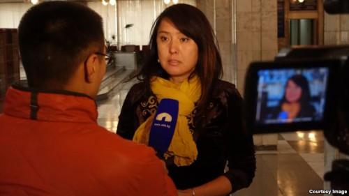 Journalist Janyl Jusupjan interviews in Bishkek