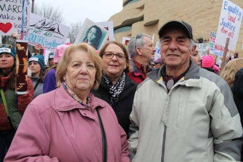 An activist woman and her activist husband protest together at the Women's March in Washington DC in January 21, 2017. Image: Elvert Barnes/Flicker CC
